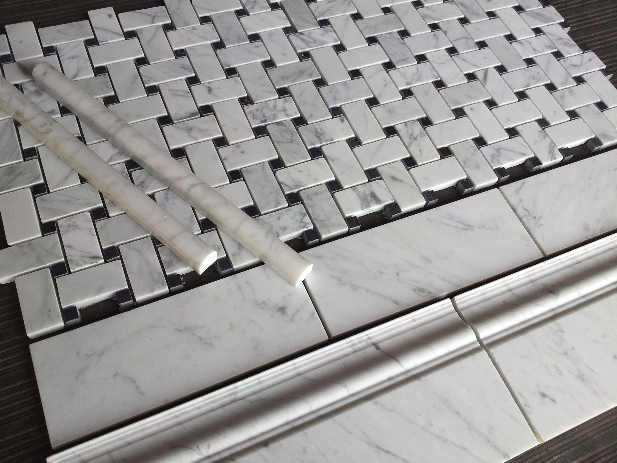 the pictures show carrara bianco honed basketweave