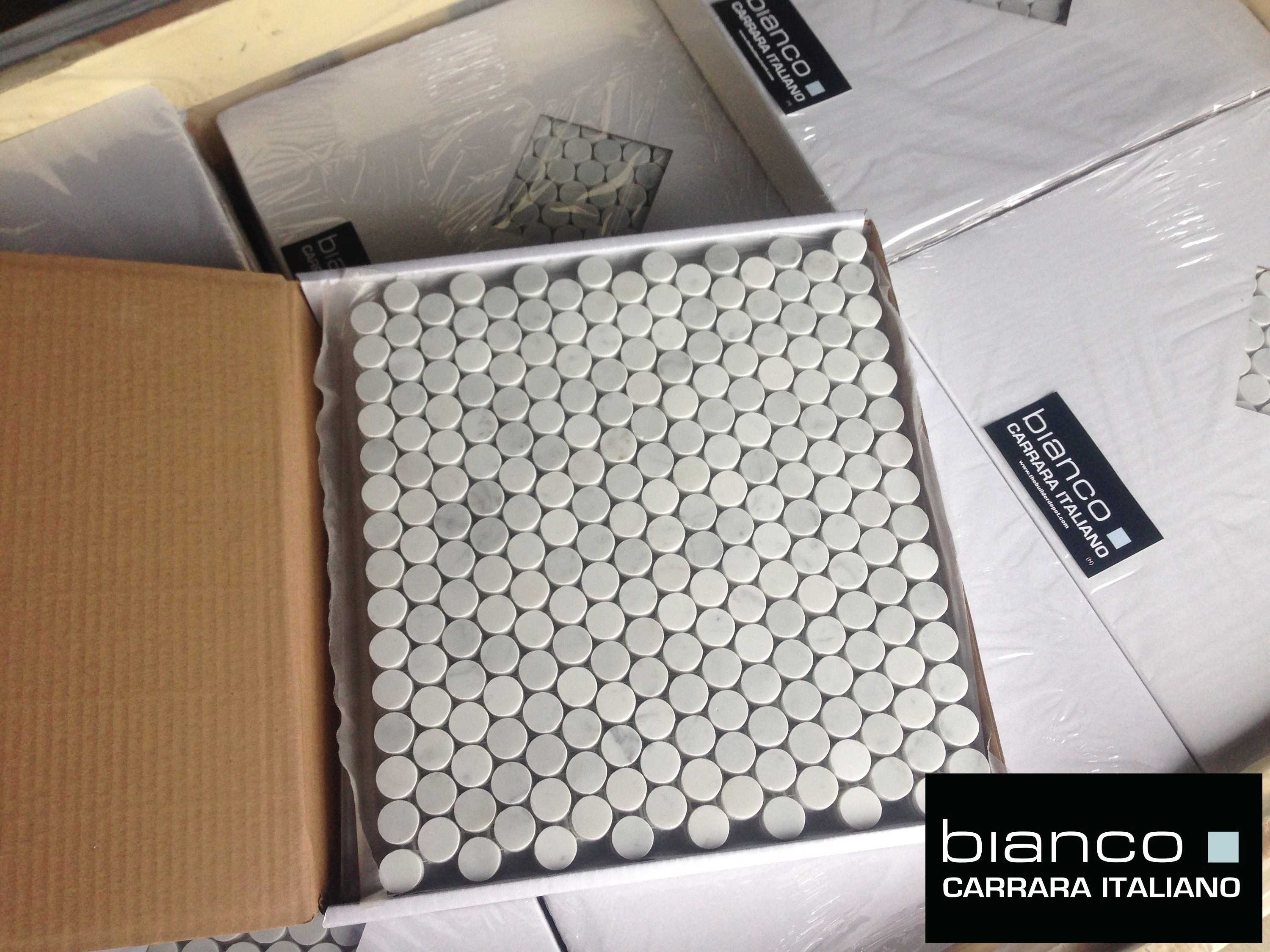 Bianco marble tile the builder depot blog carrara bianco 34 penny rounds arrive dailygadgetfo Choice Image